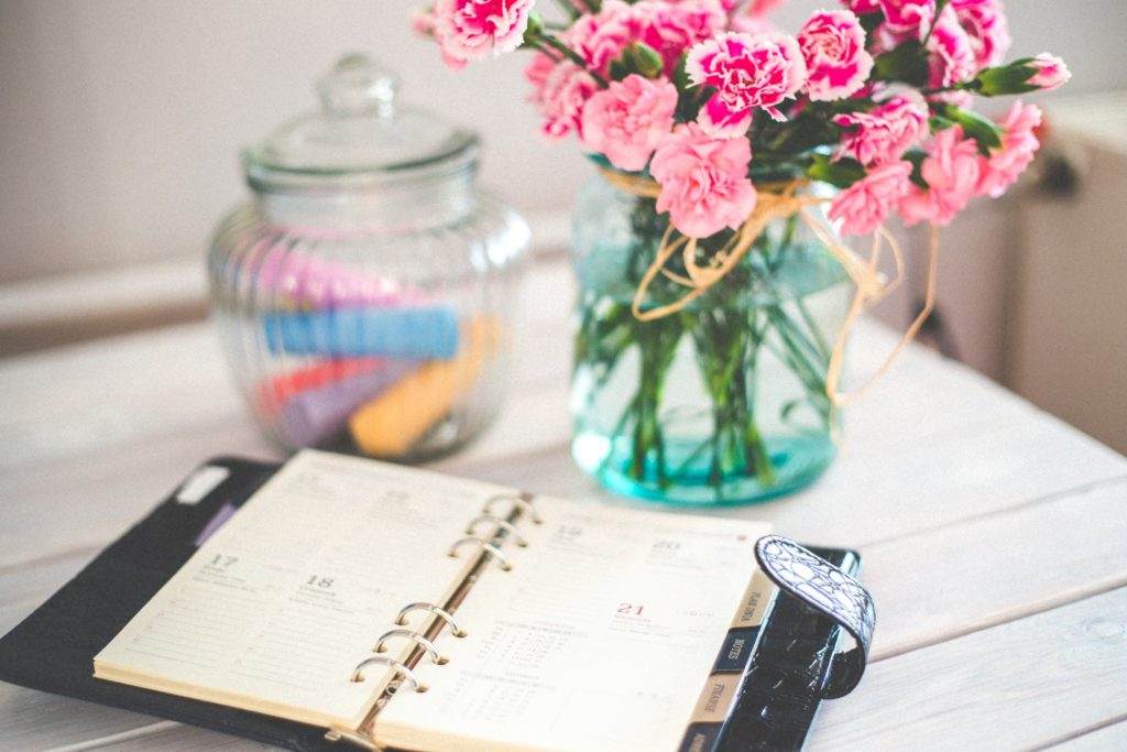 Flowers and journal on office desk