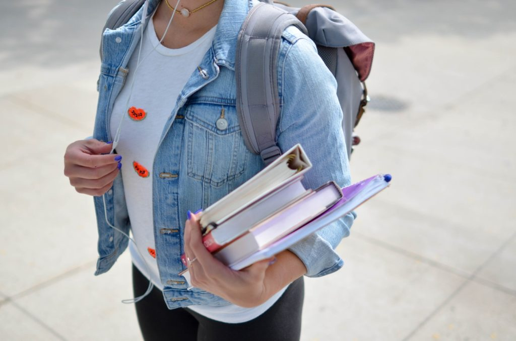 Girl going to school with books