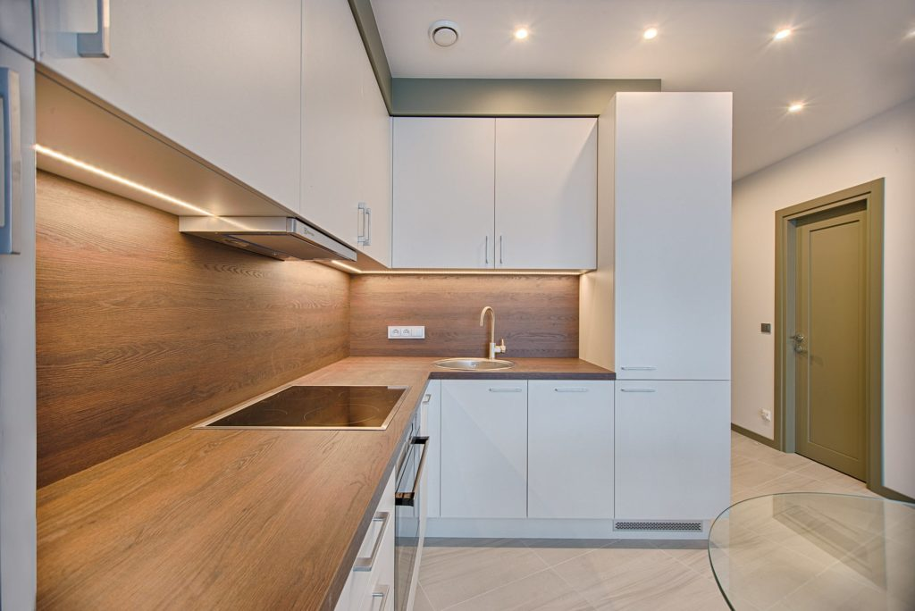 Kitchen remodel with modern appliances and cupboards